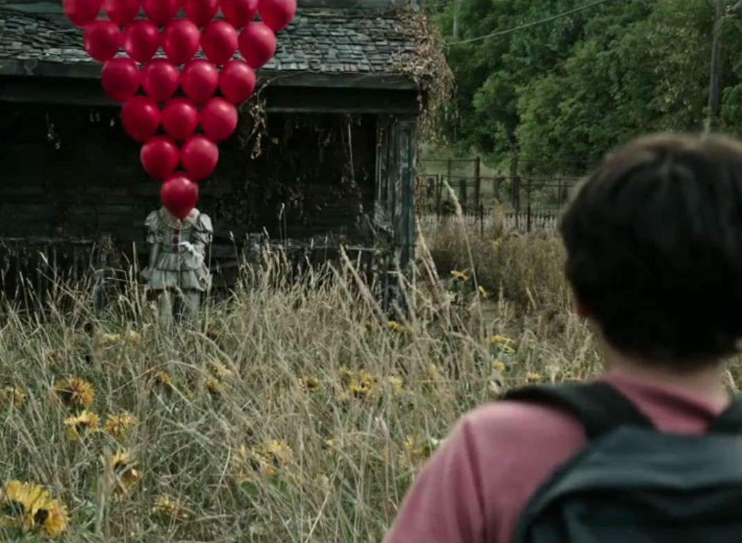 IT-palhaco-pennywise-baloes-vermelhos