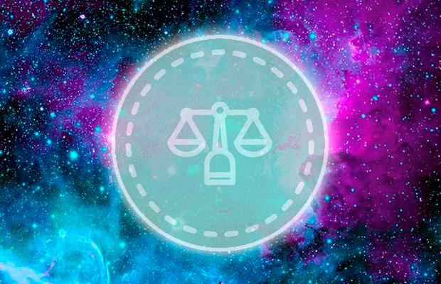 símbolo do signo de Libra em fundo de galáxia