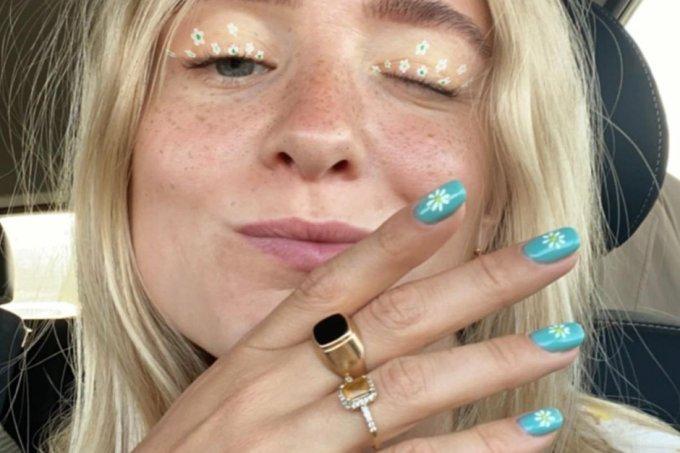 Nail art e maquiagem de margarida