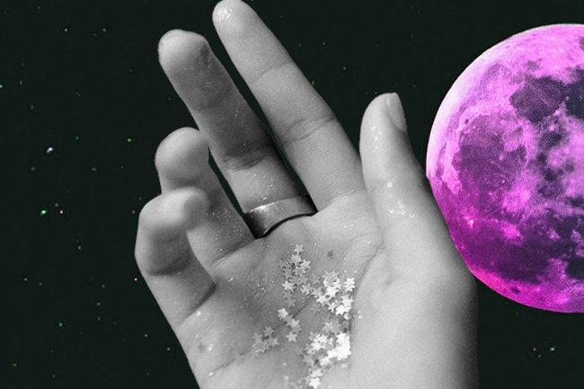 ilustração de um planeta e uma mão coberta com glitter