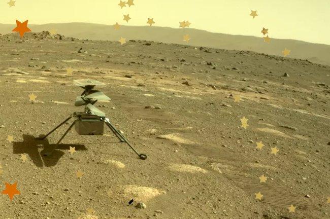 Imagem do helicóptero Ingenuity, da NASA, no solo cheio de crateras de Marte