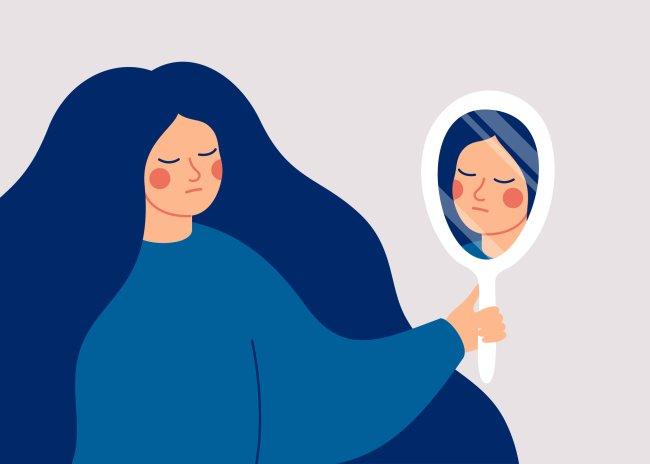 Ilustração de uma mulher se olhando em um espelho de mão, redondo. Ela não está muito feliz.