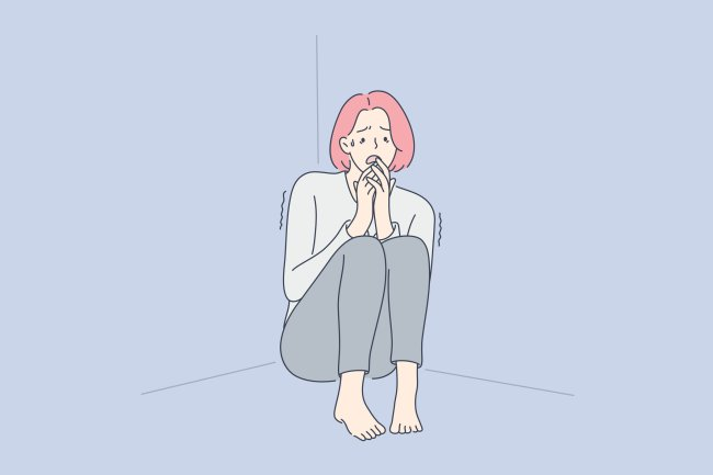Ilustração de uma mulher ruiva, encolhida no cantor da casa, com medo de sair